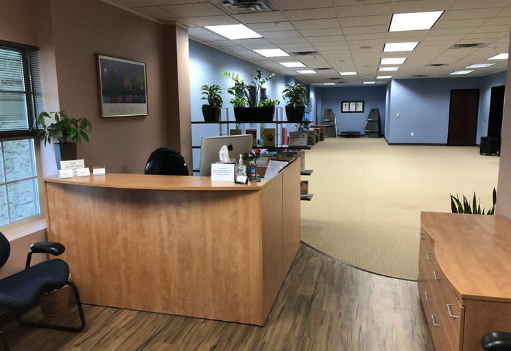 Photo of the reception area and therapy facilities at the Egoscue clinic in Austin, Texas