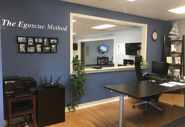 Photo of the reception area and therapy facilities at the Egoscue clinic in Boston, Massachusetts