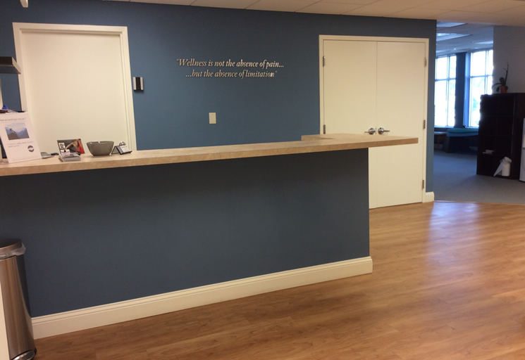 Photo of the reception area front desk at the Egoscue clinic in Tampa, Florida