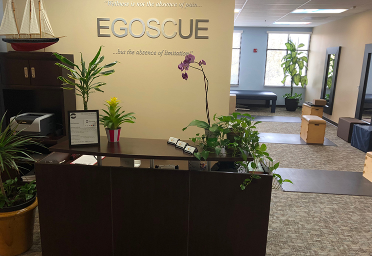 Photo of the reception area front desk and therapy facilities at the Egoscue clinic in San Diego South, California