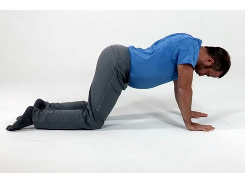 Photo of a man in a static extension pose